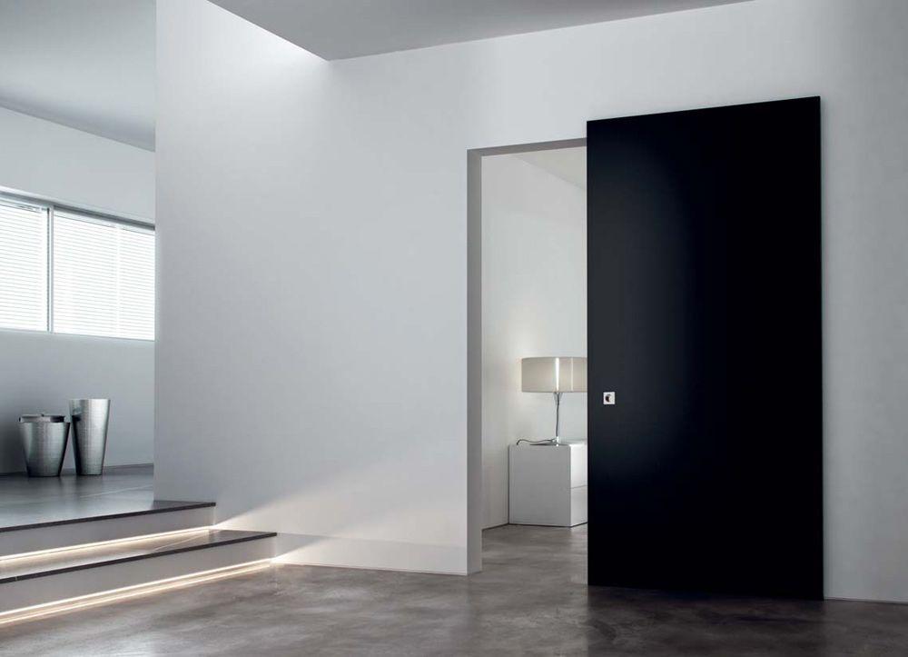Porta in legno con sistema scorrevole wanderail linear - Porte scorrevoli per interno ...